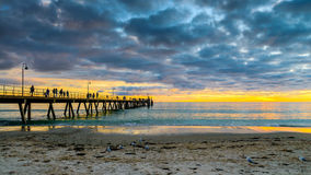 People on Glenelg Beach jetty Stock Photography