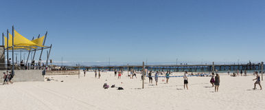 People, Glenelg Beach, South Australia. People play volleyball on the sandy beach at Glenelg, a suburb of Adelaide. This is a popular seaside destination for Royalty Free Stock Photography