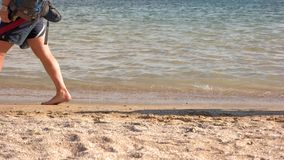 People go along the beach. stock footage