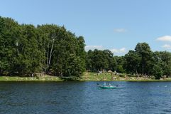 People go boating in the natural-historical park `Kuzminki-Lublino`. Stock Images