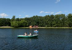 People go boating in the natural-historical park `Kuzminki-Lublino`. Royalty Free Stock Photography