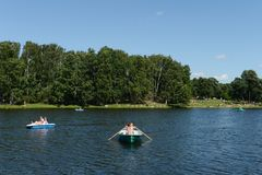 People go boating in the natural-historical park `Kuzminki-Lublino`. Royalty Free Stock Photo