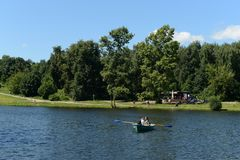 People go boating in the natural-historical park `Kuzminki-Lublino`. Stock Photos