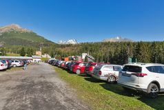 Car parking close to Strbske Lake in Slovakia. People go from car parking lor to Strbske Lake. It is a favorite ski, tourist, and health resort in the High Stock Image