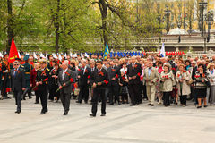 People go at ceremony of wreath laying Royalty Free Stock Image