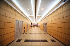 People go through  corridor in airport Stock Photography
