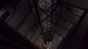 People go down the elevator from the observation deck of the town hall stock video footage