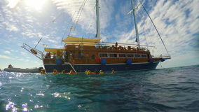 People go down into the sea with a sailing yacht stock video footage