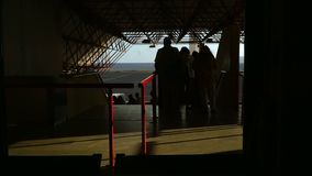 People go down the stairs to get on the plane at the airport. Exit from the airport stock video footage