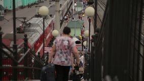 People go down to the train station stairs. People go down the stairs to the trains. railroad station. View from top stock footage