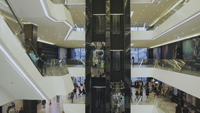 People go on the elevator at the mall stock video footage