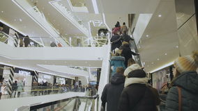 People go on the escalator stock video footage