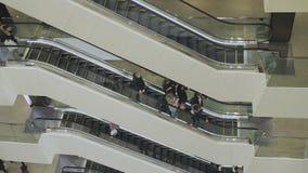 People go on the escalator stock footage