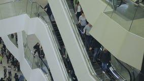People go on the escalator stock video