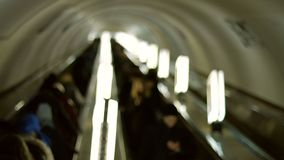 People go on the escalator. Passengers descend into the subway. Underground transport. Peak hour stock footage