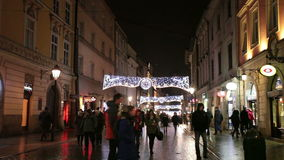 People go on the evening street of Krakow stock video footage