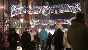 People go on the evening street of Krakow stock footage