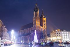 People go on the evening street of Krakow Stock Image