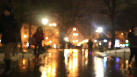People go on the evening street in the winte stock video footage