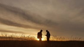 People go group travel of tourists field nature of a sunset silhouette two travel people . tourists nature people group. People go group travel tourists field stock video