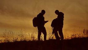 People go group travel of tourists field nature of a sunset silhouette two people travel. tourists nature people go. People go group travel tourists field nature stock video