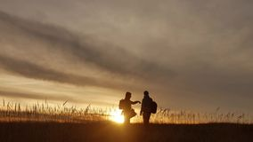 People go group travel of tourists field nature of a sunset silhouette two people travel lifestyle. tourists nature. People go group travel tourists field nature stock footage