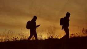 People go group travel of tourists field nature of a sunset silhouette two people travel. tourists nature go people. People go group travel of tourists field stock footage