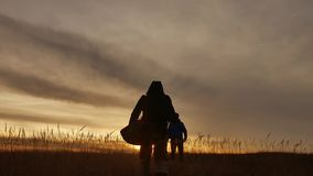 People go group travel of tourists field nature of a sunset silhouette two people travel. tourists lifestyle nature. People go group travel of tourists field stock video