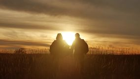 People go group travel of tourists field nature of a sunset silhouette two people travel. tourists nature people group. People go group travel tourists field stock video