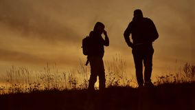 People go group travel of tourists field nature of a sunset silhouette two people travel. tourists nature people. People go group travel of tourists field nature stock footage