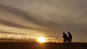 People go group travel of tourists field nature of a sunset silhouette two travel people lifestyle. tourists nature. People go group travel tourists field nature stock footage