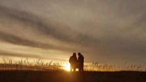 People go group travel of tourists field nature of a sunset silhouette two travel people . tourists nature people group. People go group travel of tourists field stock video