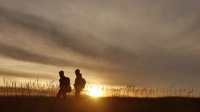 People go group travel of tourists field nature of a sunset silhouette two travel people . tourists nature people. People go group travel tourists field nature stock footage