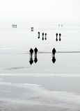 People go on the ice. Fishermen on the ice fishing on the river Dnepr royalty free stock photo