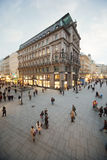 People go on intersection of streets. VIENNA- FEB 21: People go on intersection of Graben and Kartner Strasse streets - Stock-im-Eisen-Platz at evening in winter Stock Photos