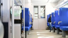 People go on modern electric train. People go on a modern electric train stock footage