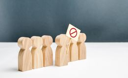 People go outside and join the protest movement. An angry mob of wooden figures of people with a poster. Social discontent. And social tension, protest and royalty free stock photos