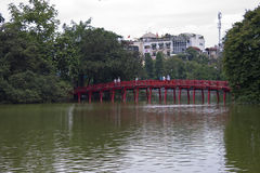 People go over Red Bridge in Hoan Kiem Lake Royalty Free Stock Photo