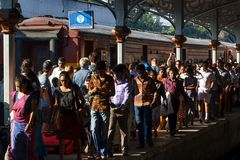 People go on the platform of the city railway station in the morning hours. Kandy, Sri Lanka - January 8, 2018. people go on the platform of the city railway stock photos