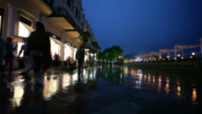 People go in rain on embankment in seaside southern city stock footage
