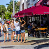 People go shopping in the afternoon sun in Lincoln Road Stock Images