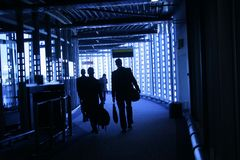 People go to boarding. At the airport, people boarding in a blue atmosphere Royalty Free Stock Photo