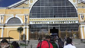 People go to the central bus station, La Paz, Bolivia. Bolivia, La Paz, 11 February 2017 - People go to the central bus station terminal, La Paz City, Bolivia stock video