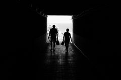 People go through the tunnel. Silhouettes. Black and white Royalty Free Stock Photos