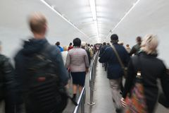 People go by underground passage to the metro at rush hour Stock Photography
