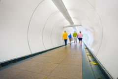 People go through underpass. Abstract photo from the center of S Stock Image