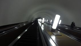 People go up and down the escalator in the subway. In Moscow stock footage