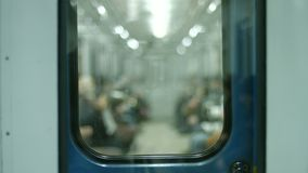 People go from work in the wagon. Time to peak. Passengers traveling in a subway car. Underground subway stock video