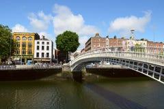 People going on Ha'penny Bridge, Liffey River in Dublin, Ireland Royalty Free Stock Image
