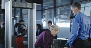 Passengers having examination in airport stock video
